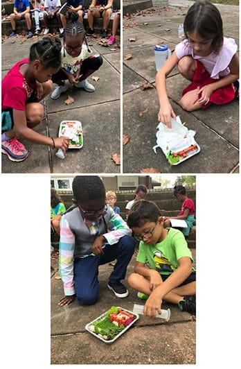 An image of students testing their designs outside.