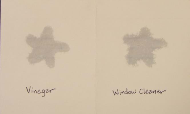 Two hand-drawn wet star shapes, one labeled vinegar, one labeled window cleaner.