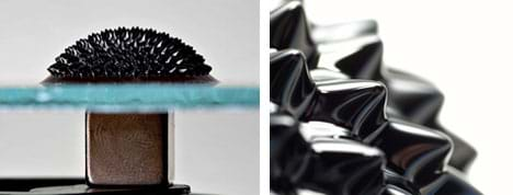 Two photos: Side view shows a glass plate on a cube-shaped magnet. On the glass, a domed and spiked shiny black material. And, a close-up of the spikes.