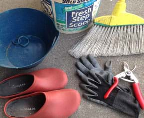 Photograph shows plastic gardening shoes, bowl, bucket, broom, clipper handles, gloves and rubber bands.