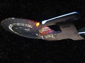 "A photograph shows a lighted replica of the star ship ""Enterprise"" from the Star Trek television and movie series, taken at the Las Vegas ""experience"" ride."