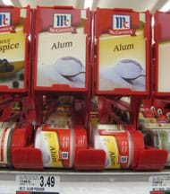 "Photo shows a shelf with little jars labeled ""Alum."""
