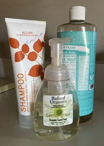 A photograph shows three cleaning products, one shampoo and two liquid soaps.