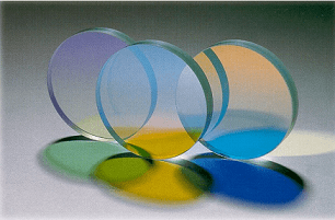 Optically transparent materials creating dichroic filters.