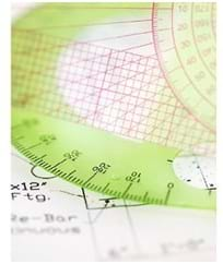 A photo shows a protractor on graph paper with equations and notes written on the paper.