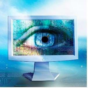 A computer screen with a human eye pictured on it.