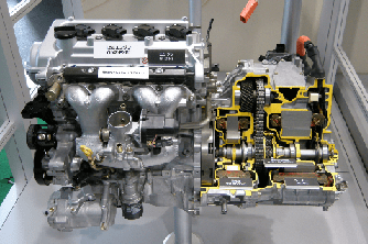 A Toyota engine showing a cutaway view of a Hybrid Synergy Drive (HSD) motor and generator.