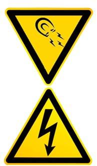 Two triangular images of magnetic and electric field warning signs. They are both bright yellow bordered in black lines, one with an image of a u-shaped magnet and the other with a jagged arrow, inside each.