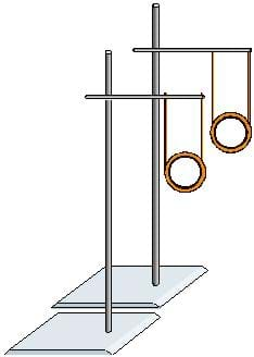 Two ring stands are next to each other, both with bars attached. A metal ring is hanging from each one such that the rings are parallel and at the same height.