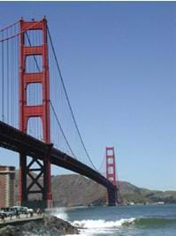 Photo shows cable bridge with two tall supports.