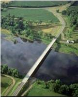Aerial photo shows a highway bridge across a river.