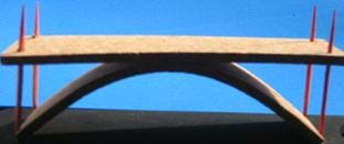 Same as the Figure 4 photo, with the addition of an arched piece under the road surface.