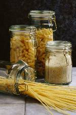 Photo shows jars of dry pasta, including spaghetti.