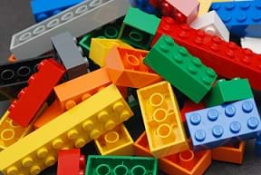 A pile of colorful LEGO blocks.