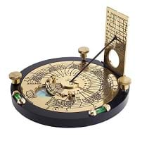 An engraved brass horizontal sundial that corrects for latitude, time zone, daylight savings time, longitude, and equation of time.