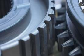 Photo shows close-up of gears, two intermeshing cogs.