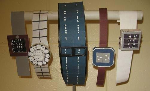 A photograph shows five different-looking student designed wristwatches, all with raised dots on the watch faces or bands.