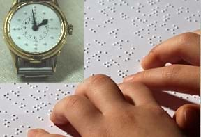A photograph shows a child's hands resting on a braille tablet. A watch is superimposed on top of the tablet.