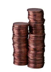 Photo shows three stacks of copper pennies.